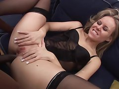 Blonde lady in erotic stockings and garter band is having wild sex with a diabolical guy
