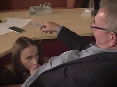 Amazing brunette with glasses is having a ffm triple at work added to enjoying it a lot