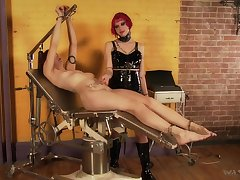 Kinky mistress in latex corset Goddess Starla is punishing one dutiful bitch
